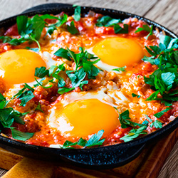 Eggs with Spinach and Artichoke Hearts Baked in Spicy Sauce