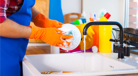 Washing dishes with hot soapy water or in a dishwasher prevents bacterial growth.