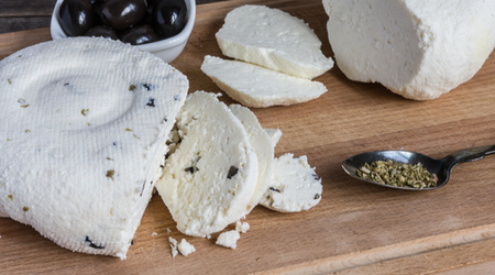 Add cut up olives to homemade cheese for an additional homely touch