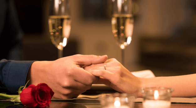 Romantic cuttlery with glasses of champagne for two