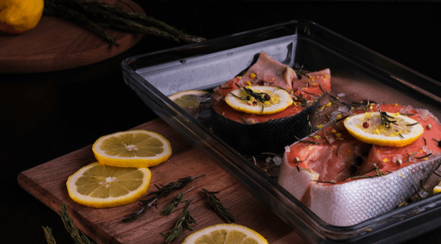 Salmon fillets in a tray with lemon