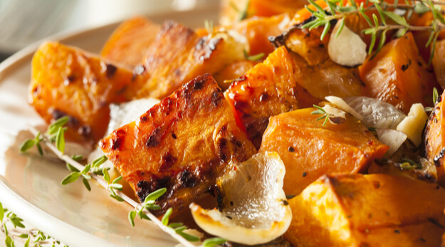 baked sweet potatoes with herbs on a plate