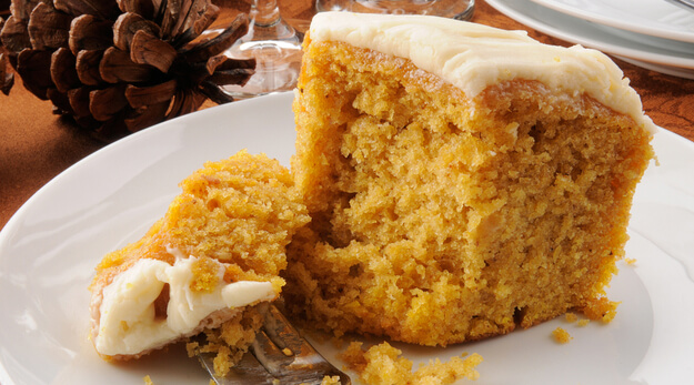 pumpkin cake with creamy white frosting