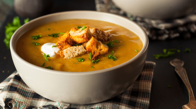 butternut squash soup in a white bowl