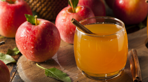 apple cider with spices and cinnamon stick