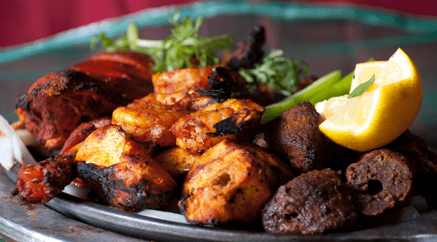 tandoori chicken on a metal plate