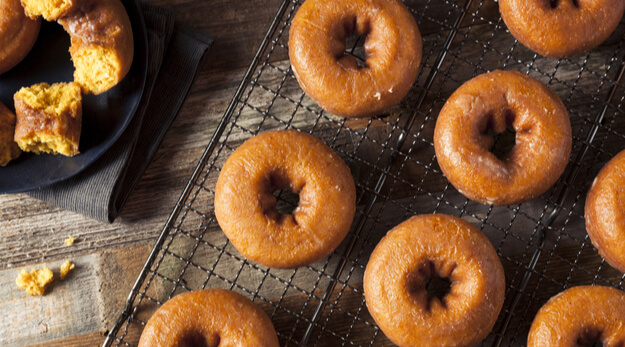 doughnuts with pumpkin on a wooden table