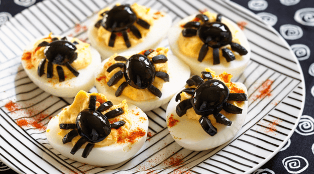 Halloween-style deviled eggs with spiders made from black olives